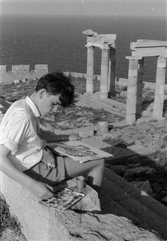 Boy painting a Greek temple...