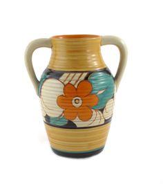 'Floreat' a Clarice Cliff Fantasque Bizarre twin-handled Lotus jug