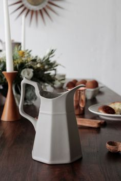 Grey bone china water pitcher for tabletop gatherings.