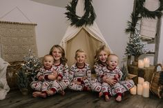 holiday mini session photo shoot christmas pajamas siblings neutral teepee greenery garland candles tree lights ladder reindeer blondes