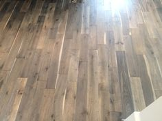 """""""Iron Springs"""" wood flooring.  Lightly distressed with shades of taupe, grey, and brown."""