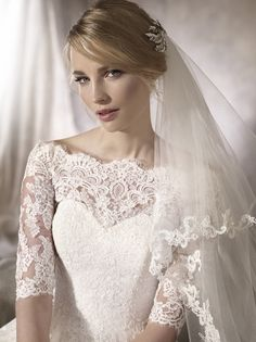 Haloke WEDDING DRESSES 2017 Delicate princess wedding dress with a tulle skirt and lace and gemstone appliqué that descend over the bodice to an envelope neckline and elbow length sleeves. La Sposa Wedding Dresses, Bridal Gowns, After Wedding Dress, Gowns With Sleeves, Lace Tops, Bridal Collection, Wedding Planner, Marie, Photos