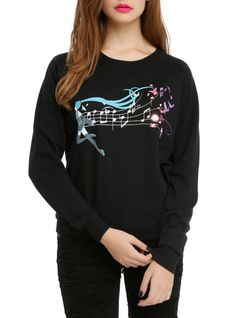 Black pullover top with a Hatsune Miku music notes design on front.
