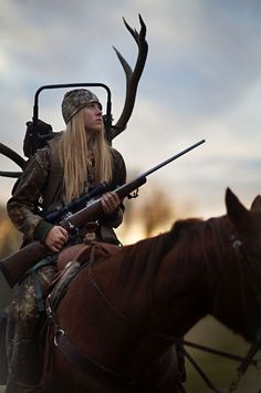 15 year old hunter Harlee with her trophy elk rack. The rack itself is big but her father has taught her to only kill what they can eat, not for sport.