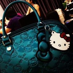 Hello Kitty Purse  http://re.mu/treechada/product/169 LOVE this color!