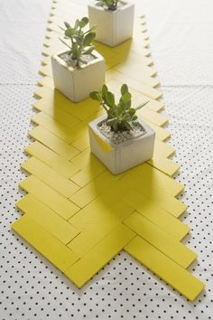 The yellow brick road of table runners — made from plain wood paint sticks.