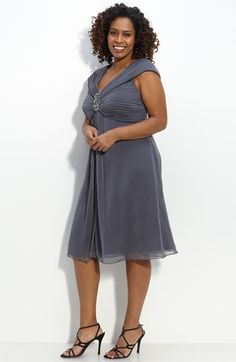 A deep v-neck draws attention away from the hips.  This dress is a lovely choice for a semiformal or formal wedding.