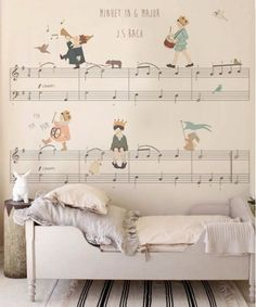 Children playing their musical instruments while sitting on Bach's musical notes and scales accompanied by little animals marching to the beat of the music. This mural is perfect to decorate your little one's bedroom! Elaborated in high quality materials, can be customized to the measures of the wall. Shipped worldwide by @babybottega