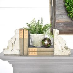 """Vintage inspired distressed corbel bookend pair. 5"""" H"""