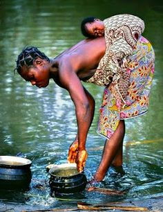 Mother and child. (We go to our sinks for water, how far does she go. how much does she carry?)