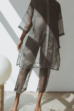 Update and refine your wardrobe with this sheer fashion forward style from Mixed Business LA. This versatile piece pairs beautifully with matching organza pants or a pair of relaxed denim jeans.