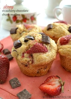 Soft, fluffy, and bursting with juicy strawberries and gooey chocolate chunks muffins | wholeandheavenlyoven.com