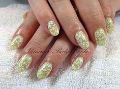 Gel nails, glitter nails, green nails, short round nails, stamping nail art by Shimmer Body Studio.