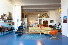 """One day I want an Eames rocker in my life. """"Kelly's Retro Artist Loft in Downtown LA, via Apartment Therapy. Retro Living Rooms, Living Spaces, Turbulence Deco, Artist Loft, Blue Floor, Piece A Vivre, Floor To Ceiling Windows, Retro Furniture, Decoration"""