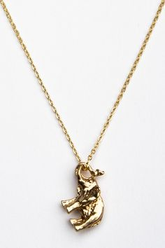 Gold elephant necklace. Finally found one with the trunk facing up--it's good luck :)