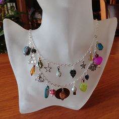 Bohemia Charms One - Beaded Charms Silverplated Swag Necklace, via Etsy.