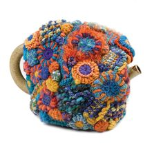 https://flic.kr/p/agVYmR | Tcosy - Freeform Crochet 1 | Created in freeform crochet using an assortment of natural & synthetic yarns, I used a wadded padding & commercial felt to line the inside to ensure maximum heat retention