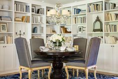 design :: martha o'hara The Ikea Billy bookcase can be made to look like built-ins as in this gorgeous dining room.