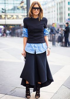 Christine Centenera masterfully layers a black tee over a chambray button-up, paired with a voluminous skirt and cut-out heels