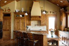 Knotty Alder Kitchen Inset Raised Panel and Bead Board Doors Kitchen Oconomowoc, WI Knotty Alder Kitchen, Knotty Alder Cabinets, Kitchen Gallery, Raised Panel, New Kitchen, Kitchen Ideas, Kitchen Cabinetry, Custom Cabinetry, Traditional Kitchen