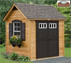 This cute little shed was made from a storage shed kit! Great for gardening tools or even a playhouse. (Legacy Cedar Storage Shed Kit 8 x 6 Floor Included - Suncast)