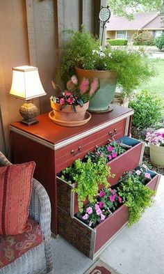 s 15 whimsical ways to use old furniture in your flower bed, gardening, painted furniture, repurposing upcycling, Fill drawers of an old dresser with flowers