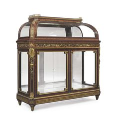 A NAPOLEON III ORMOLU-MOUNTED KINGWOOD AND MAHOGANY VITRINE-CABINET BY GUILLAUME GROHE, PARIS, THIRD QUARTER 19TH CENTURY
