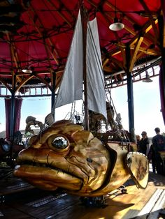 Big Fish on the upper deck of the triple decker carousel Mondes des Marins at the Les Machines museum/experience Nantes France