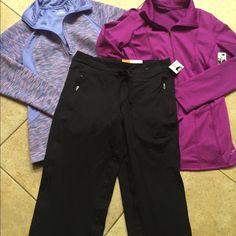 Champion DuoDry bundle of 3 size Size S NWT bundle includes a purple zip  front jacket made from DuoDry material for a comfortable stretch and a dry fit size M.  A zip front pink/blue jacket with thumb hole detail on sleeve size M A pair of DuoDry semi- fitted pants with zip pockets Tags attached no flaws Champion DuoDry Other