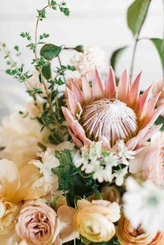 King Protea With Rosaprima Roses In Nuetral Gardenstyle romantic Arrangement | Colonial House of Flower
