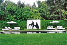 Set against a white backdrop, a black Alexander Calder sculpture appears to dance above the water in a pool at a private home in Holmby Hills, California. Garden Pool, Garden Art, Outdoor Rooms, Outdoor Gardens, Outdoor Living, Modern Gardens, Outdoor Furniture, Alexander Calder Sculptures, Pool Water Features