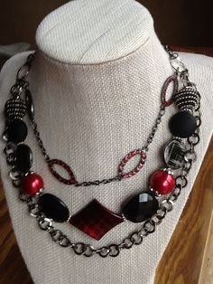 Red and black acrylic and glass beads combined with gunmetal chains and red crystal links.