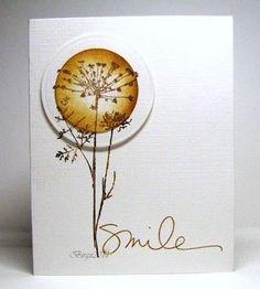 Oh, wow....//This is beautiful!  It looks like the image was stamped on the card stock and then twice onto a scrap piece of card stock.  Cut both with circle cutter.  On bottom circle it appears to have had an embossed edge added.  Top circle was inked to add color.  Then line them up and adhere to main card using pop dots.  :)