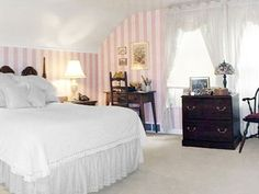 To transform this plain bedroom, the homeowners decided to tear down the dropped ceiling and basic wallpaper.