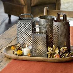 Salvaged shredders make a lovely table display with the illumination of votive candles twinklin through.Group an assortment of round and classi group on a tray with fall flowers or leaves for a seasonal accent. To be safest, use LED lights instead of candles.