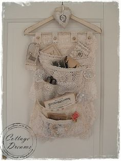 tuck vintage postcards into pretty wall hanging with pockets