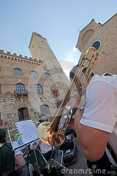The trumpeter at the Bavarian orchestra at the streets of San Gimignano. Italy