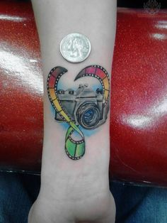 Color Film And Camera Tattoo On Wrist. I like the heart/film idea. Don't love colors or the camera.