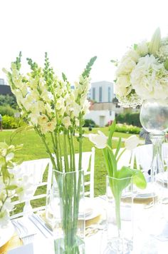 Pretty flowers at a white wedding party! See more party planning ideas at CatchMyParty.com!