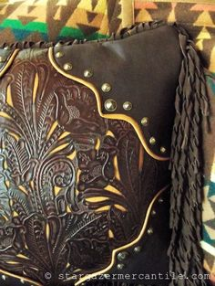 It's all in the details! Our rich brown #leather #Western style #pillow with golden buckskin filigree overlay adds warmth and texture to any interior!  Available now at http://stargazermercantile.com