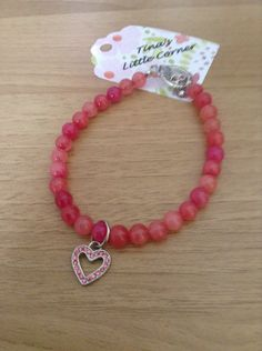 A personal favorite from my Etsy shop https://www.etsy.com/listing/280837450/pink-bead-bracelet-heart-charm