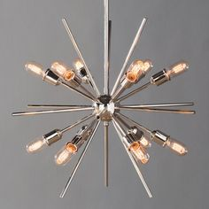 Mid Century meets modern times with this timeless and uniquely artistic sputnik pendant. It features twelve arms to fit twelve exposed bulbs, adding elegance and drama to your dining room, living room, fo Sputnik Chandelier, Chandeliers, Langley Street, Contemporary Chandelier, Modern Contemporary, Mid Century Lighting, Atomic Age, Beautiful Lights, Polished Nickel