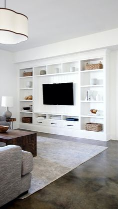Grab these DIY plans and build super sleek and stylish media built-ins complete with plenty of shelves and inset drawers! Living Room Wall Units, Living Room Built Ins, Living Room Tv Unit Designs, Home Living Room, Wall Cabinets Living Room, Storage In Living Room, Fireplace In Living Room, Tv Wall Unit Designs, Built In Cupboards Living Room