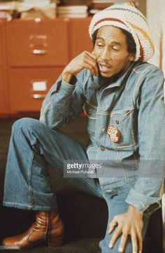 Jamaican reggae singer-songwriter and musician Bob Marley (1945 - 1981) pictured wearing a denim jacket, jeans and a rastacap at the offices of Island Records, London, 24th July 1975.
