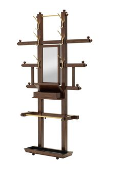 Hall Tree with Umbrella Stand The inspiration for this hall tree beckons from the Victorian-era. The simplicity of the decorative ball elements, coupled with the addition of contemporary brass hooks and a rich dark walnut finish creates a piece that is an elegant addition to any entryway.
