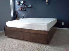 Platform-Bed-with-Drawers:   Make the drawers go all the way across so they can be accessed from either side of the bed. No wasted space in the center like the DIY bookshelf bedframe ideas....Sarah's room?