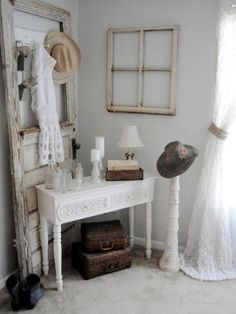 "Dedicate an entire space to a rustic theme. The turn-of-the-century hat and old-timey door match perfectly with the vintage ivory table and apothecary jars. The neutral, white color scheme unites the ""shabby"" with the ""chic."""