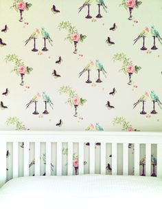 White bed frame & Nina Campbell Wallpaper.    © Tiffany Grant-Riley