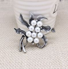 $2.59 Gorgeous Pearls Floral Brooch. A lovable piece of art. Get yours on www.baoshy.com