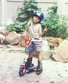 He's in rollerblades trying to ride a scooter.i wonder where nct got their craziness from? Nct Taeyong, Jaehyun Nct, Nct 127 Members, Ntc Dream, Ty Lee, Childhood Photos, Nct Life, Mark Nct, Wattpad
